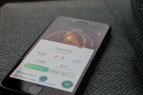 Turned-on Iphone Displaying Pokemon Go Charizard Application