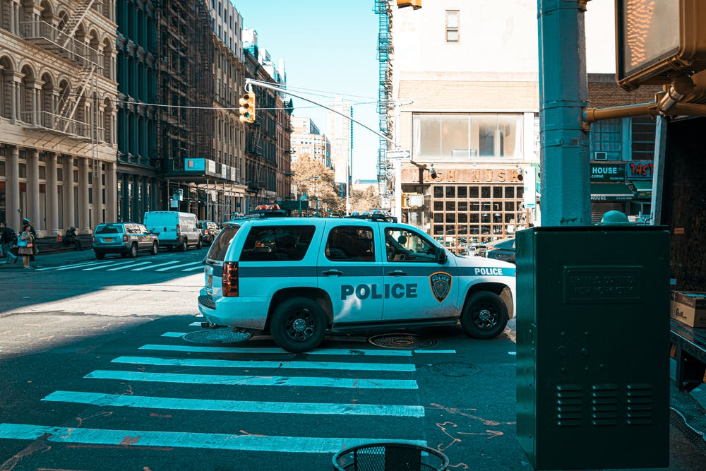 A white police car.   Photo: Pexels