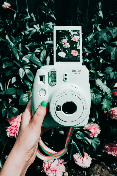 White Fujifilm Instax Camera