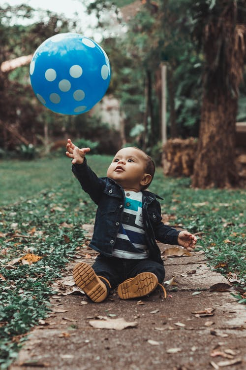 Toddler Playing With A Balloon