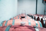 Photo of Wine Glass on Top of Barrel