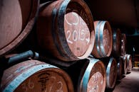Pile of Brown Wooden Barrels