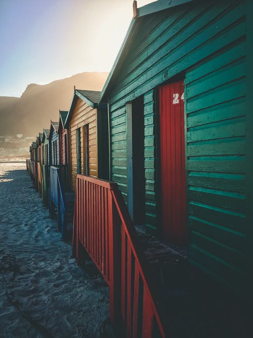 In-lined Wooden Cottages With Different Colors