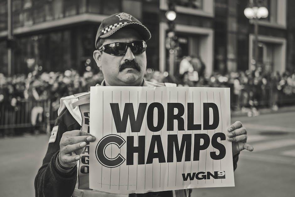 Monochrome photo of man holding signage