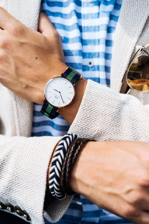 Man Wearing Jacket and Watch