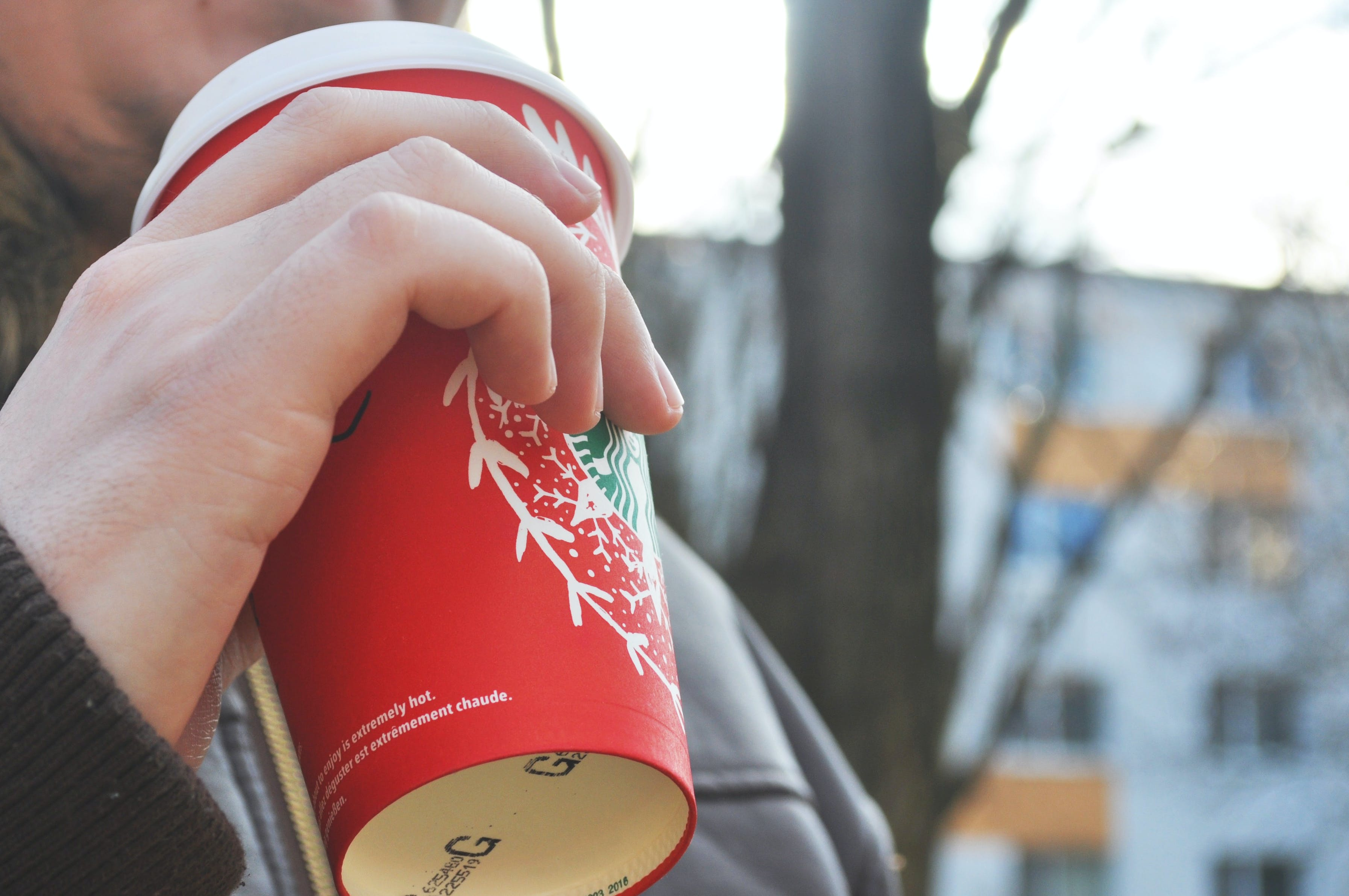 Person Holding Red Cup