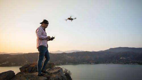 Man Flying A Drone