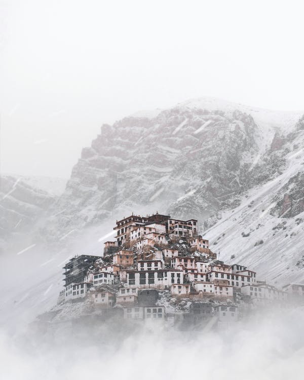 Landscape Photo of a Village by a Snowy Mountain