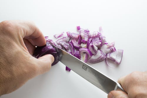 Person's Chopping Onion