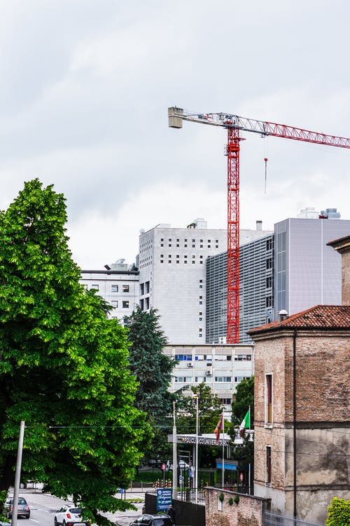 Red Crane Tower Beside White Building