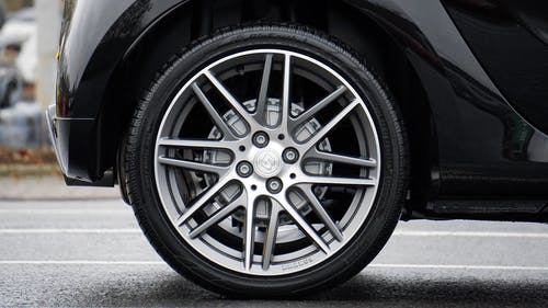 Close-up Photograph of Chrome Vehicle Wheel