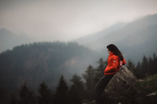 Photo of Woman Leaning on Boulder