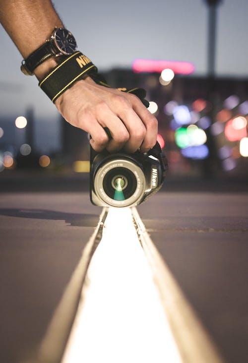 人, 光, 尼康粉絲, 弱光 的 免費圖庫相片