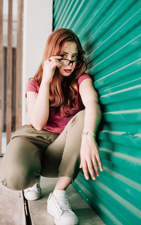 Photo of Woman Leaning On Roller Shutter