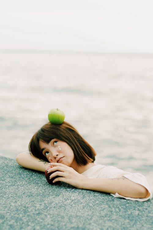 Green Apple on Girl's Head
