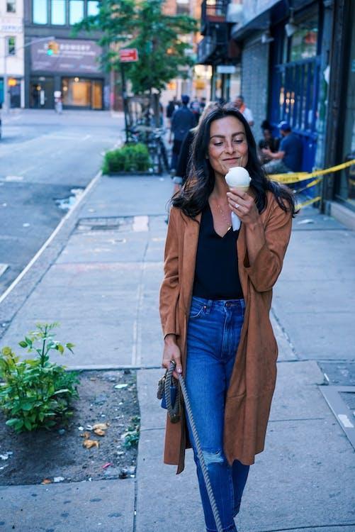 Woman Wearing Brown Coat during Daytim E
