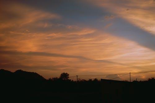Kostnadsfri bild av solnedgång, stråle, våg