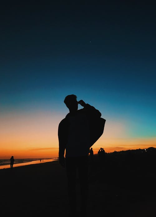 Silhouette of Man Wearing Backpack