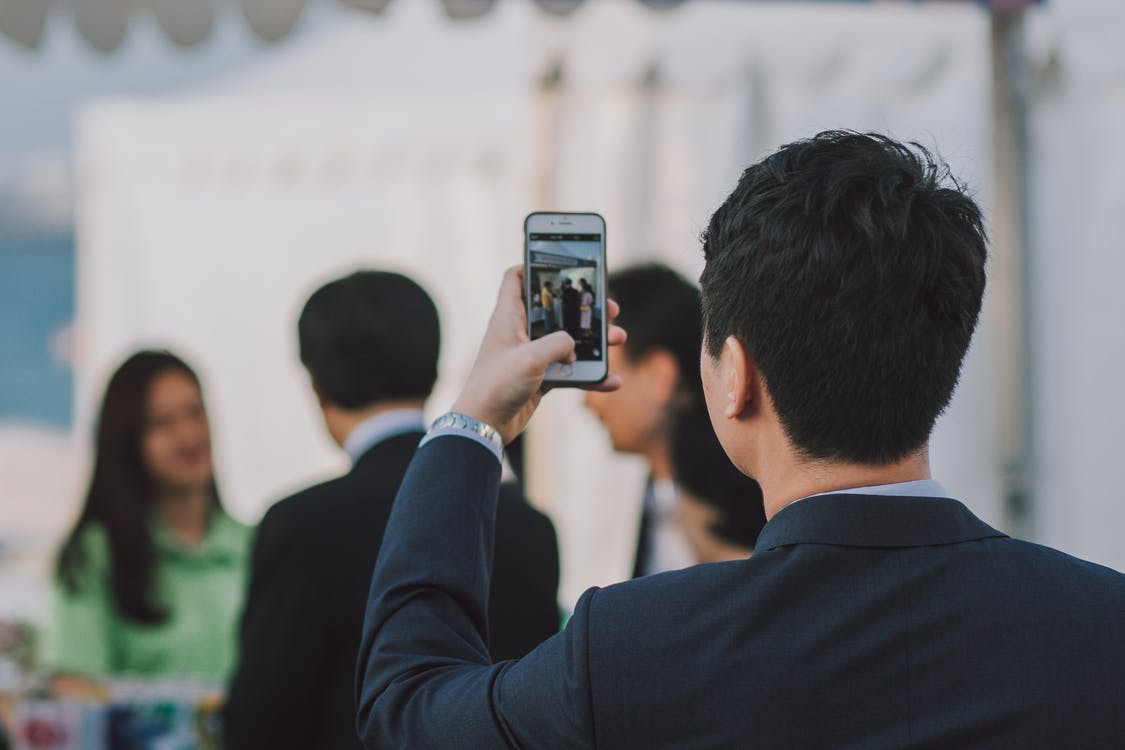 Man Taking Picture on People