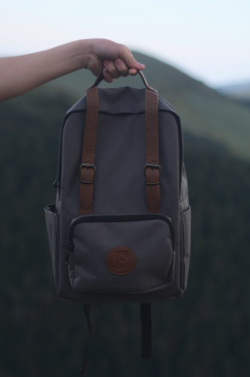 Photo of Person Carrying Backpack