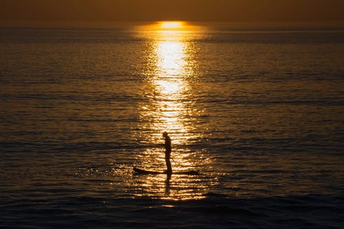Darmowe zdjęcie z galerii z morze, pomarańcza, słońce, sport