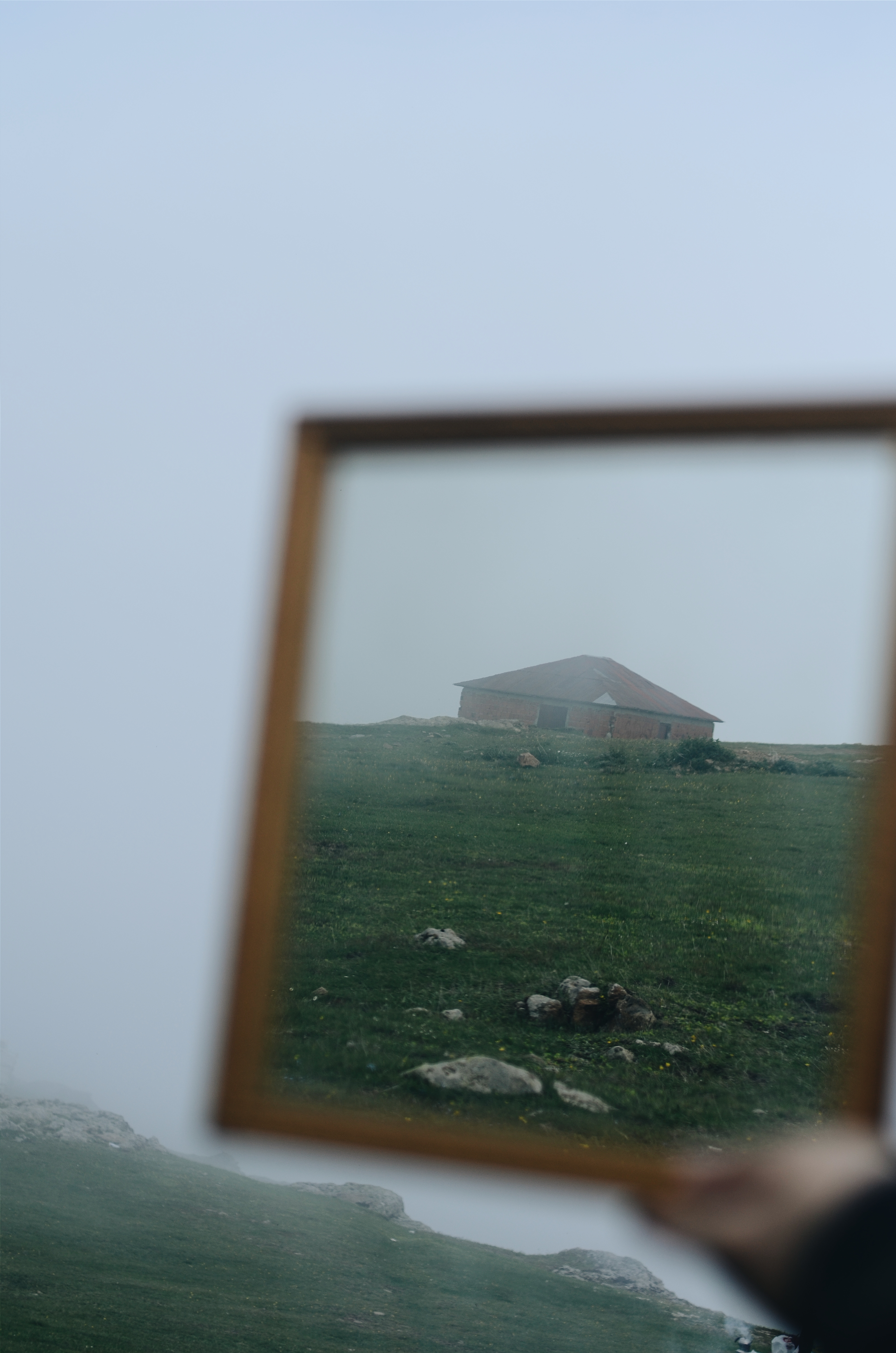 Blurred Reflection of a Brown House on a Framed Mirror