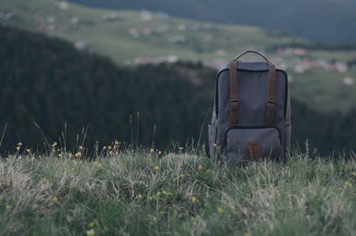 Close-Up Photo of Backpack On Grass