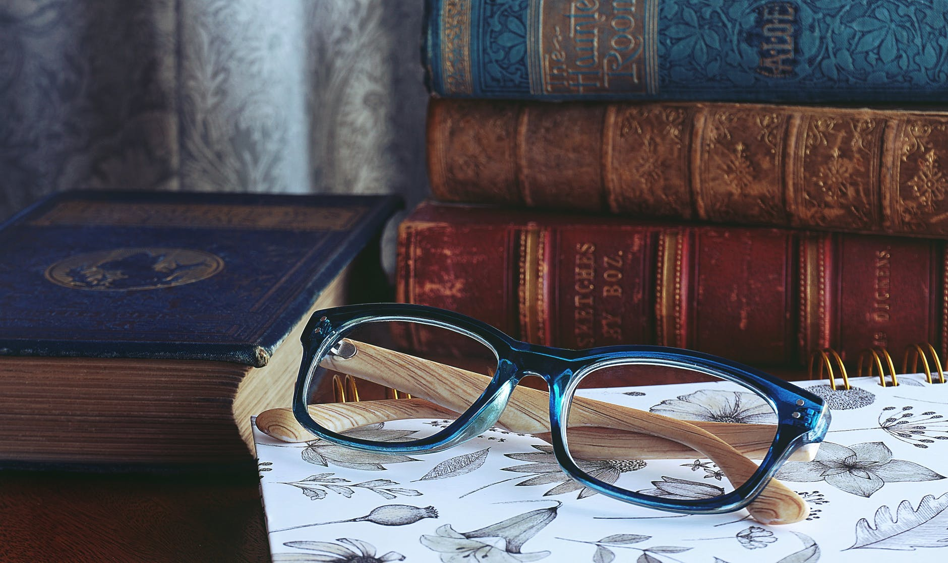 EnChroma Glasses beside a couple of books at the table
