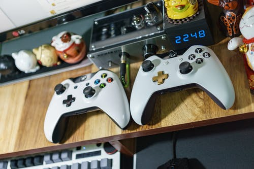 White Xbox One Controllers on Table