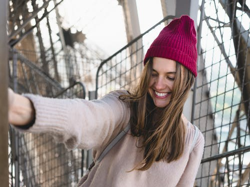 Photo of Woman Wearing Maroon Beanie