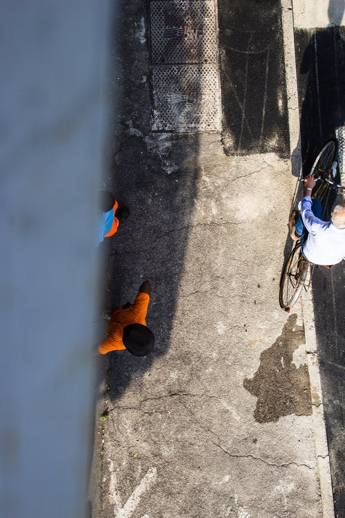 Free stock photo of above, bicycle, construction workers, from above