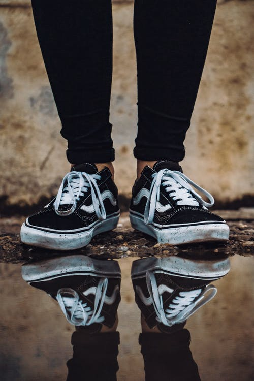 Reflection of Vans Sneakers on Water