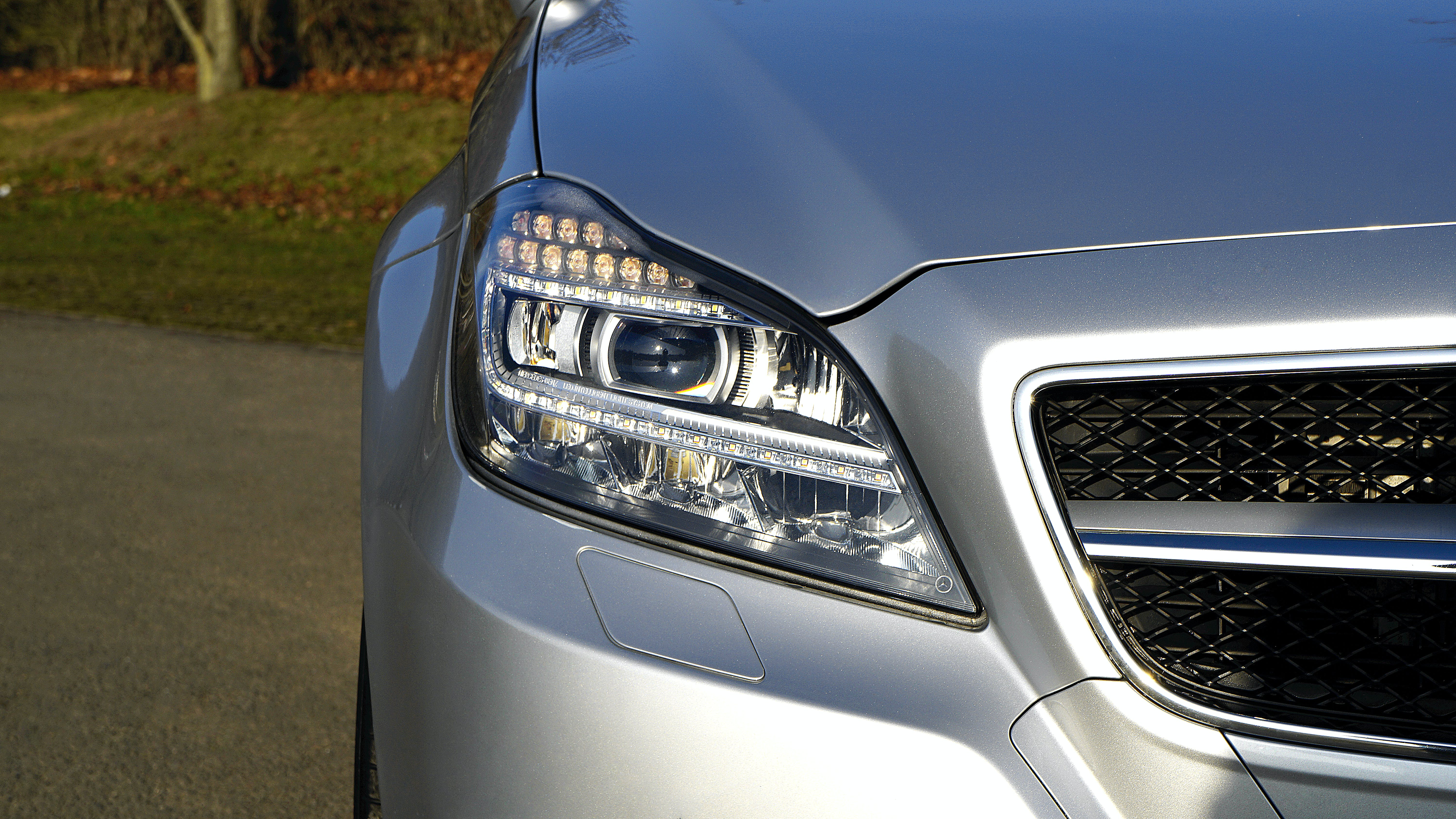 Projector Headlight of Silver Car