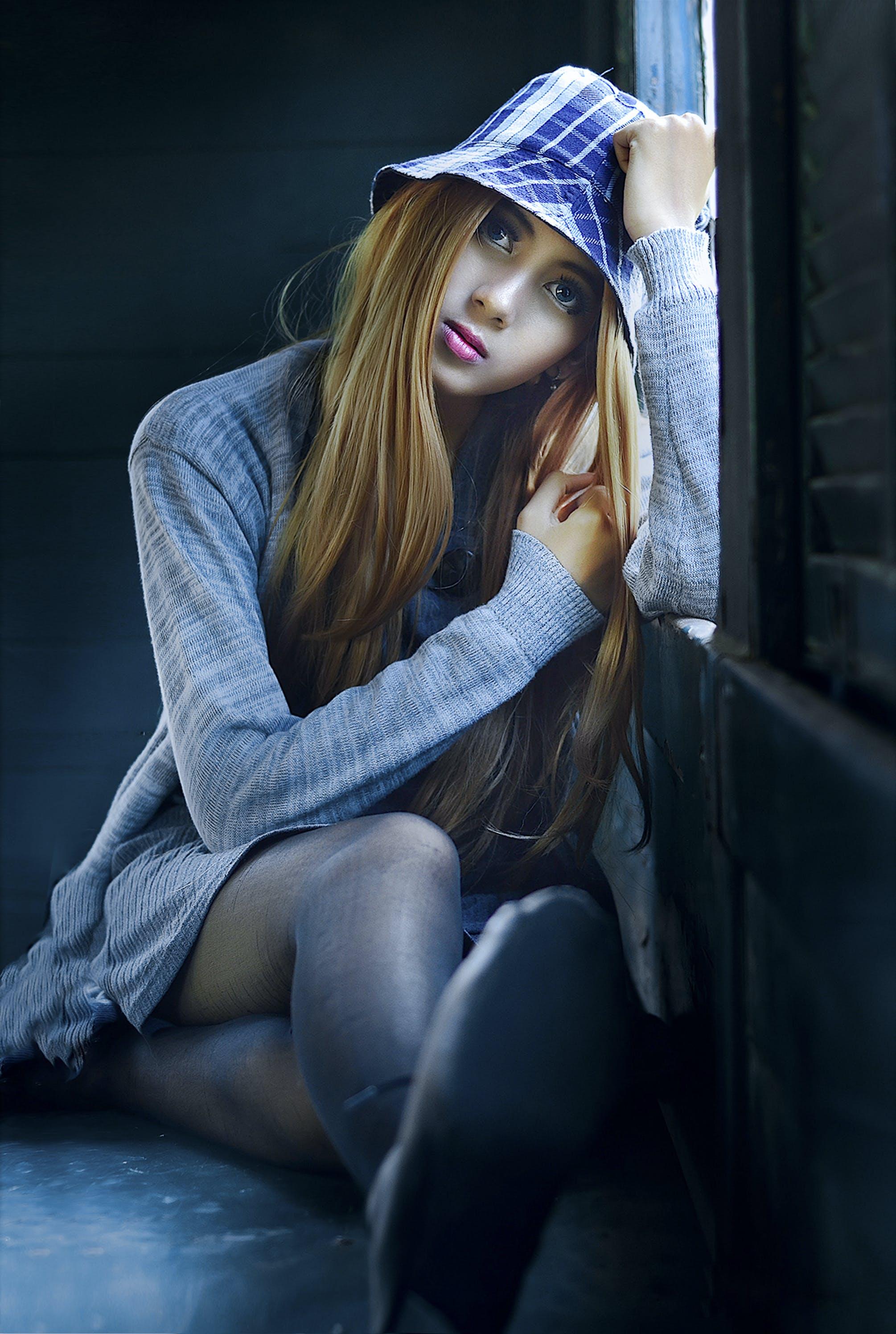 Woman Wearing Heather-gray Cardigan Leaning on Window
