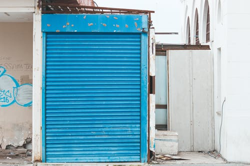 Closed Blue Metal Roll-up Door