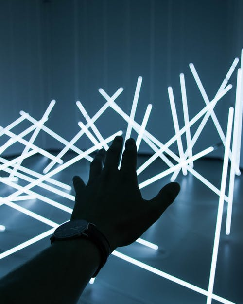 Person Reaching For Glow in The Dark Sticks