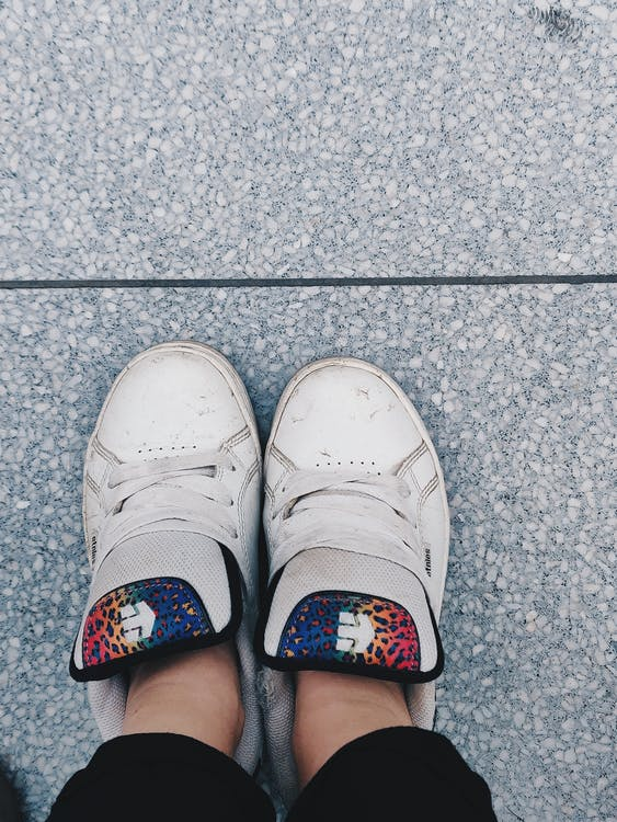 Photo of Person Wearing White Shoes