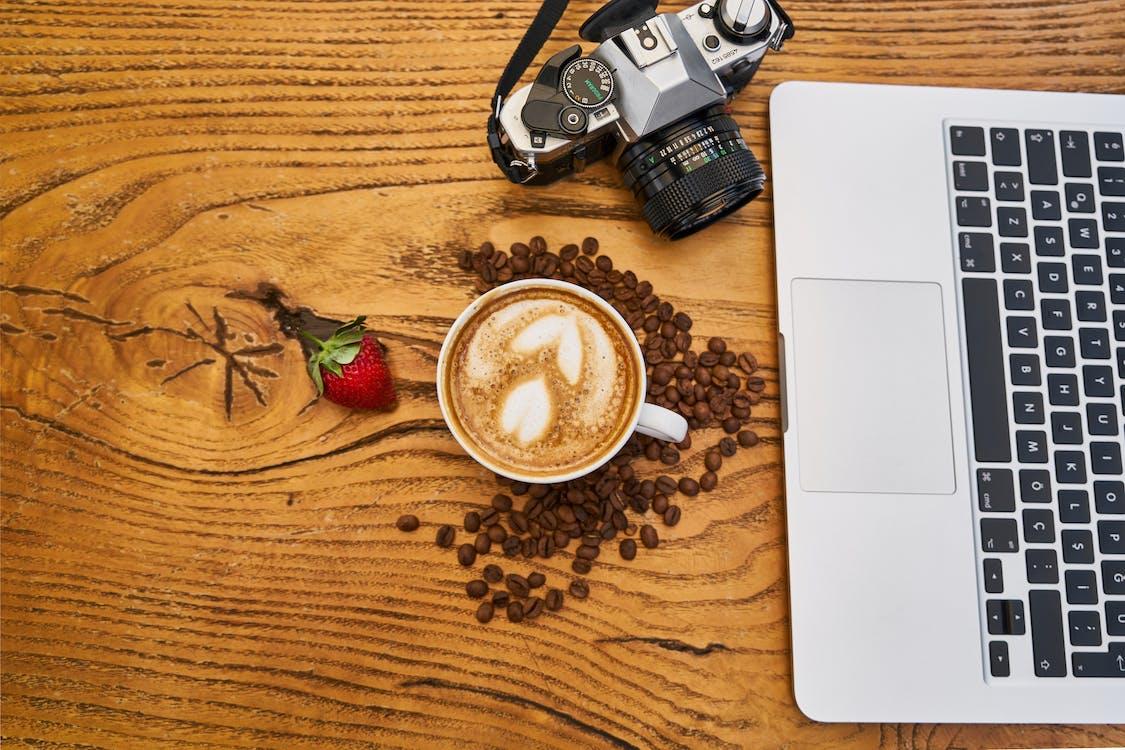 Latte Art Beside Laptop