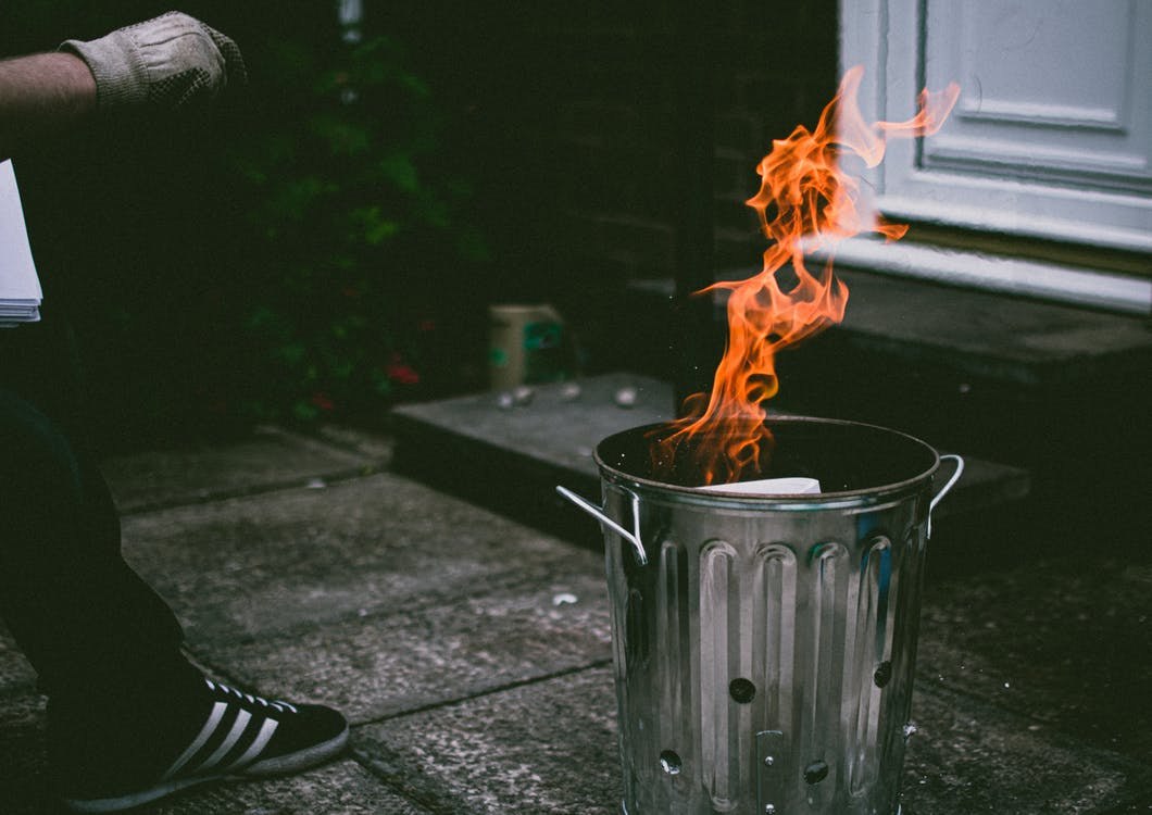 Stainless Steel Trash Can On Fire