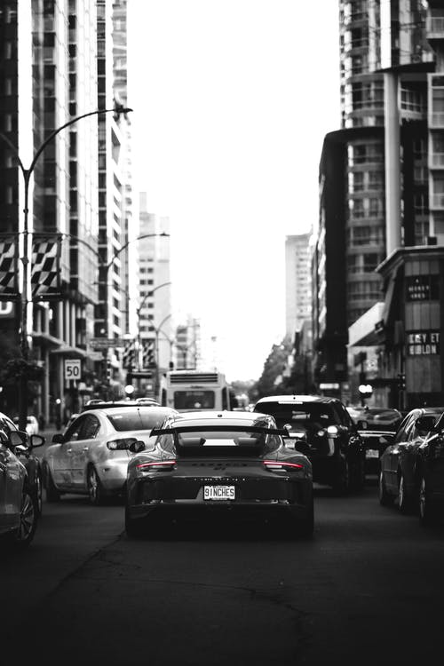 Free stock photo of black car, car, city, city center