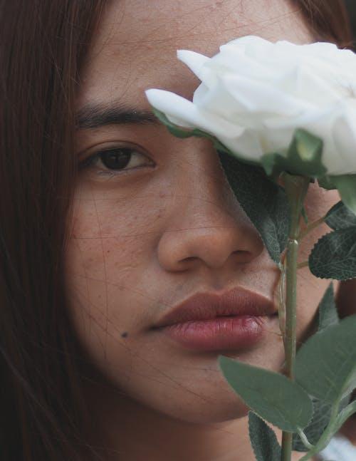 Woman Behind White Rose