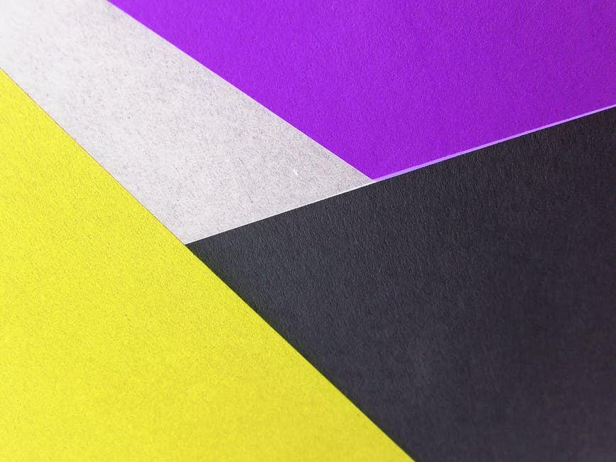 Yellow black and purple colored papers