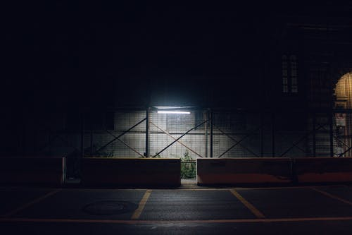 Glowing light in industrial warehouse at night