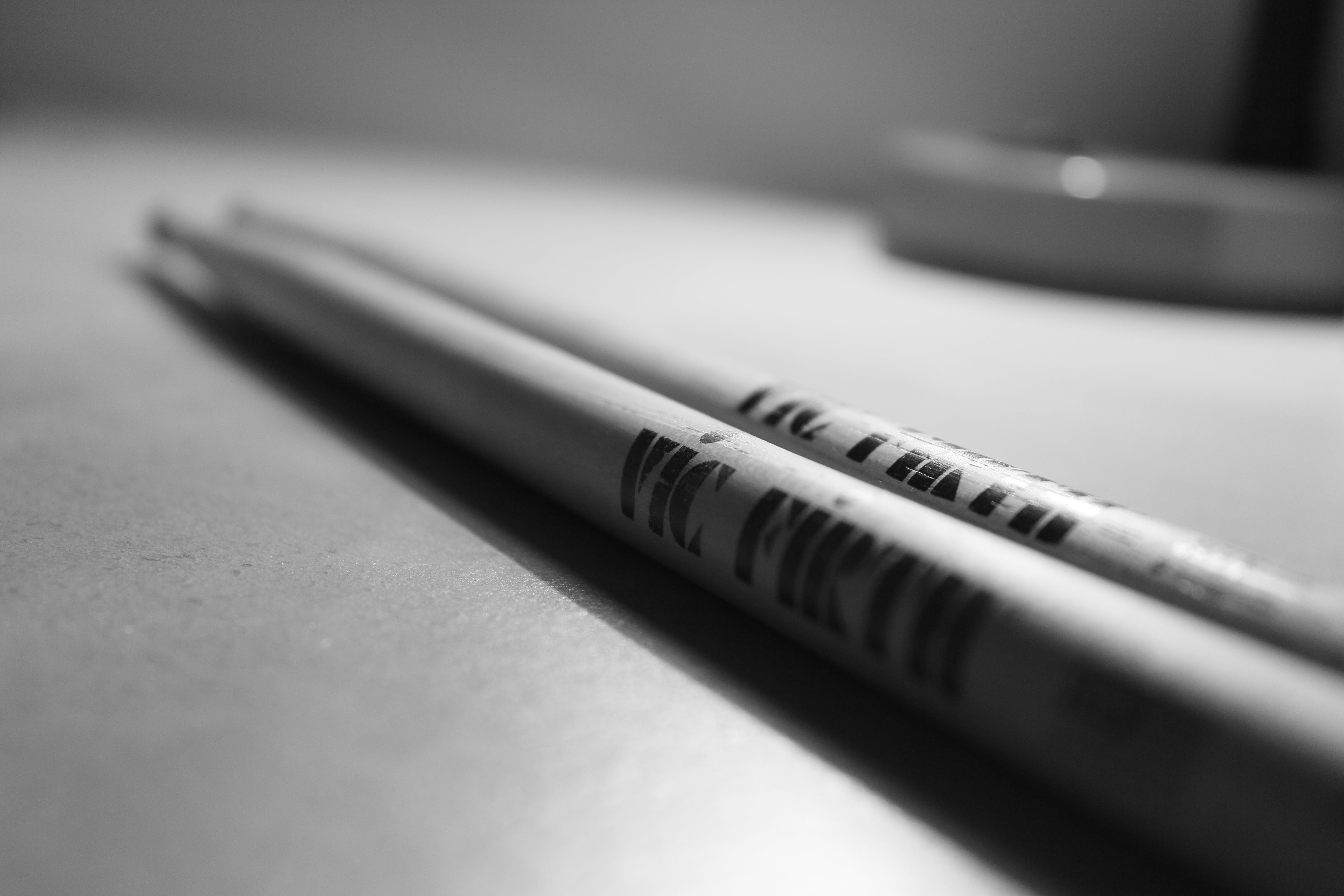 Selective Focus Photography of Pair of Drumsticks
