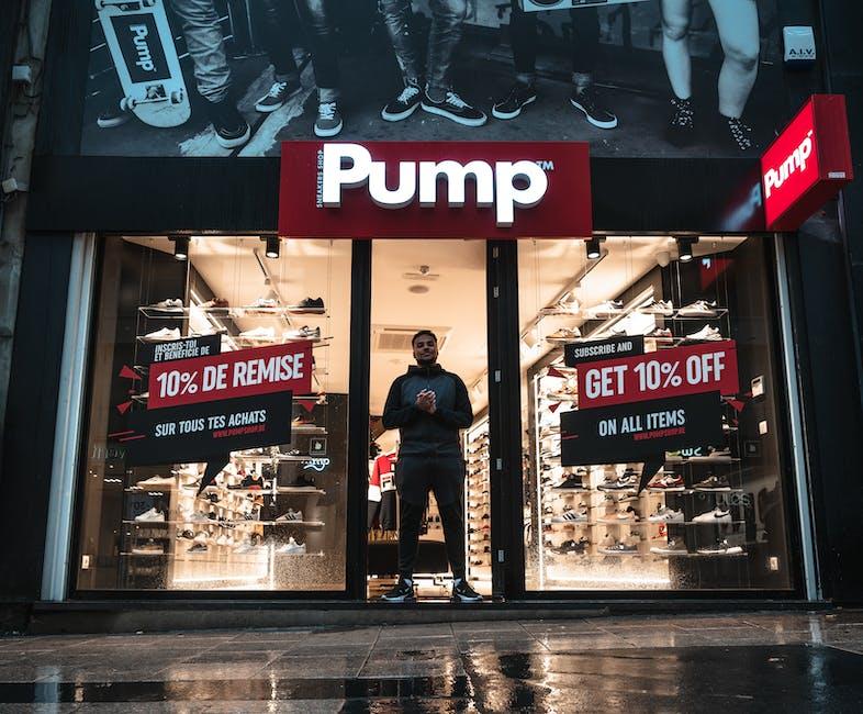 Man standing at the doorway of pump shop