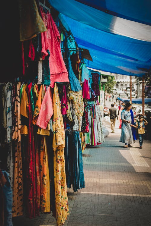 Stores On Sidewalk Selling Clothes