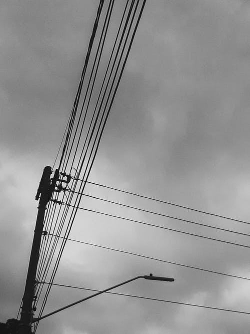 Greyscale Photography of Electric Post