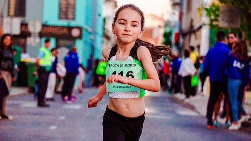 Photo of Girl Running on Street