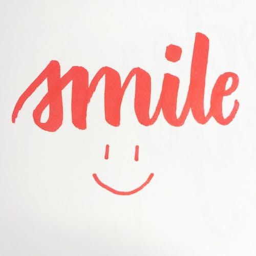 Kostenloses Stock Foto zu hand schriftzug, handschrift, lächeln