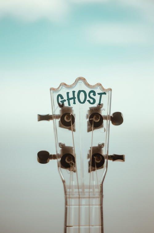Shallow Focus Photo Of Guitar Head Stock